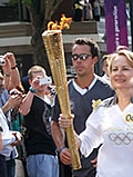 Danuta Ryland carrying the Olympic Torch through Finchley, London 2012.