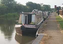 Photo of a row of moored canal boats on the Ashby Canal