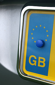 Image of the left-hand end of a registration plate showing the letters GB within the European U, nion ring of stars, yellow on a blue background