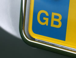 Image of the left-hand end of a registration plate showing the letters GB within the European Union ring of stars, yellow on a blue background